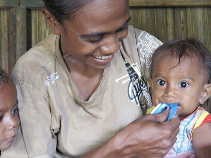 mother feeding her child